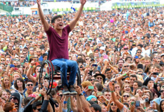 SAN FRANCISCO, CA - AUGUST 10:  A music fan crowd surfs at the Lands End Stage during day 2 of the 2013 Outside Lands Music and Arts Festival at Golden Gate Park on August 10, 2013 in San Francisco, California.  (Photo by Jeff Kravitz/FilmMagic)