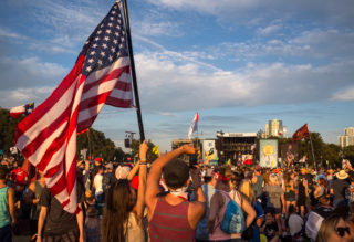 Olivia Stout holds up an American flag while her boyrfriend, Dylan Ionnotti, snaps a photo of Willie Nelson performing on the final day of the second weekend of the 2016 Austin City Limits Festival at Zilker Park Oct. 9. 10/09/16 Tom McCarthy Jr. for AMERICAN-STATESMAN